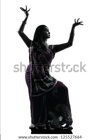 one indian woman dancer dancing in silhouette studio isolated on white background - stock photo