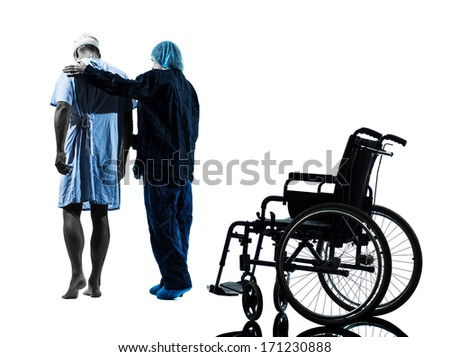 one injured man walking away from wheelchair with nurse in silhouette studio on white background - stock photo