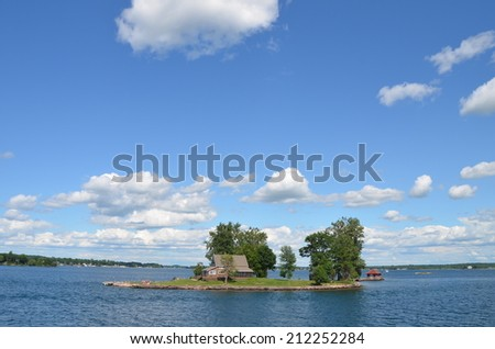 One Island in Thousand Islands Region in fall of New York State, USA - stock photo