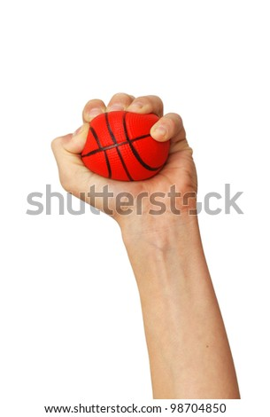 one isolated hand squeezes small sponge basketball toy ball over white background - stock photo