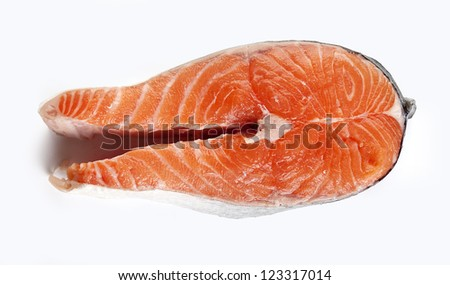 One isolated raw steak of salmon on the white