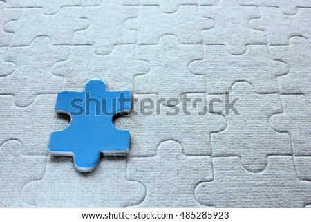 One jigsaw  puzzle on the paper