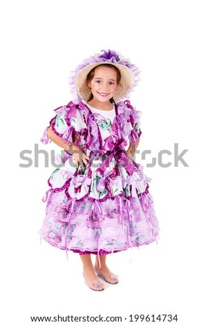 One kid wearing generic caipira clothes as in every Festa Junina or Country Festivals in Brazil. - stock photo