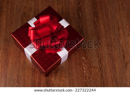 one large red gift box top view on a wood background - stock photo