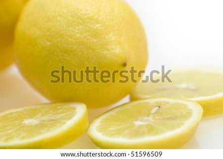 One Lemon and three slices lemon,focus on foreground; close-up view