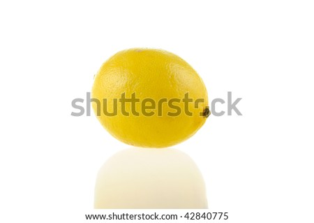 One lemon on a white background with reflection
