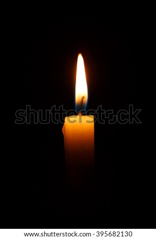 One light candle burning brightly in the black background - stock photo