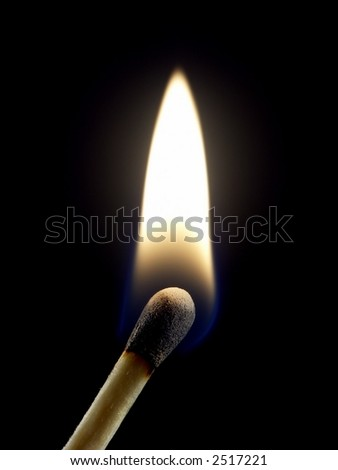One lit wooden matchstick isolated on black background. - stock photo