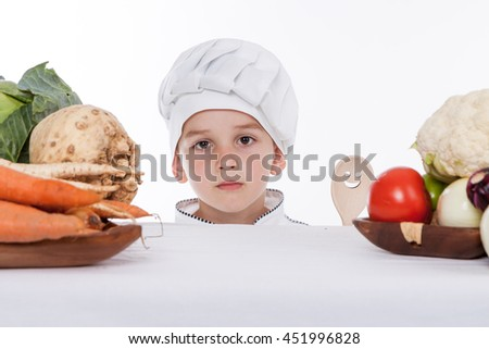 One little boy as chef cook making salad, cooking with vegetables. Isolated on white. - stock photo