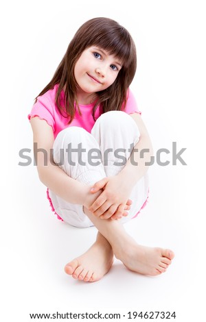 ONE LITTLE GIRL ON WHITE BACKGROUND - stock photo