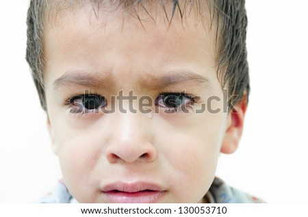 One lonely child weeping on white background - stock photo