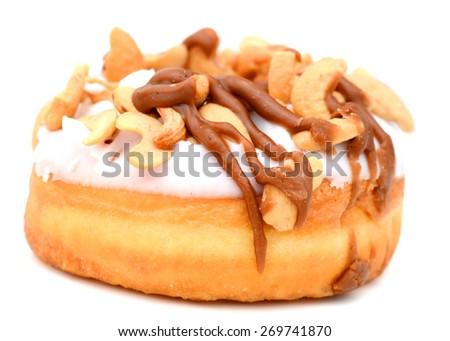 one lovely caramel cashew donut isolated on white  - stock photo