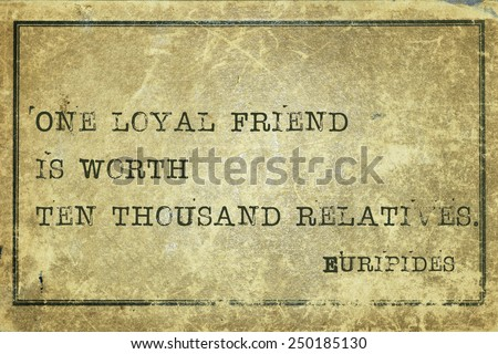 One loyal friend is worth ten thousand relatives- ancient Greek philosopher Euripides quote printed on grunge vintage cardboard - stock photo