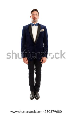 One male model wearing elegant suit and bow tie posing in straight position on white studio background