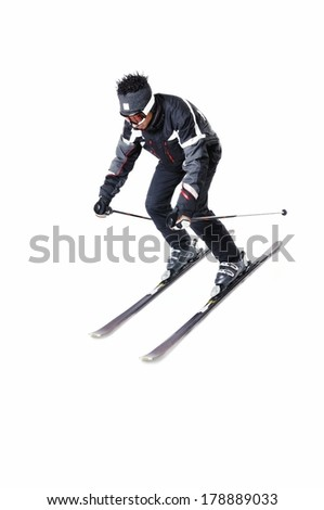 One male skier skiing on a white background