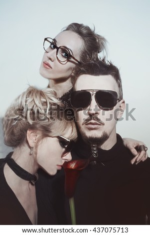One man and two women wearing sunglasses