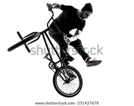 one  man exercising bmx acrobatic figure in silhouette studio isolated on white background - stock photo