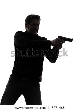 one man killer policeman aiming gun portrait silhouette studio white background - stock photo