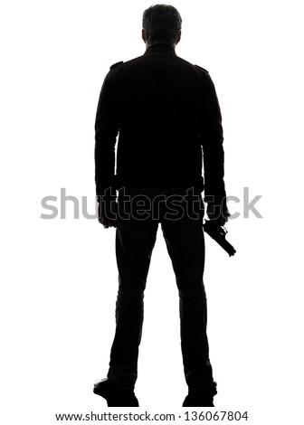 one man killer policeman holding gun silhouette rear view studio white background - stock photo