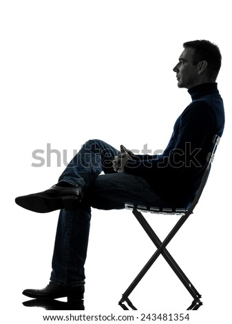 back of beach chair silhouette. one man sitting looking up full length in silhouette studio isolated on white background back of beach chair
