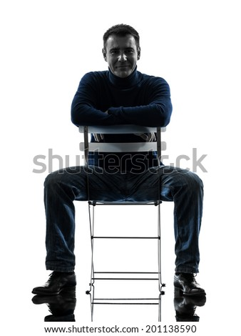one  man smiling looking at camera full length in silhouette studio isolated on white background - stock photo