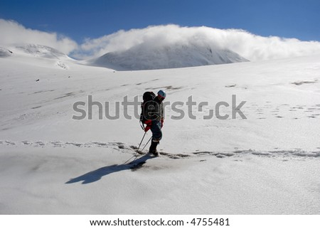 One man trekking  on a glacier.