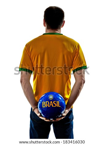 one man with brazilian jersey holding soccer ball back isolated in white background - stock photo