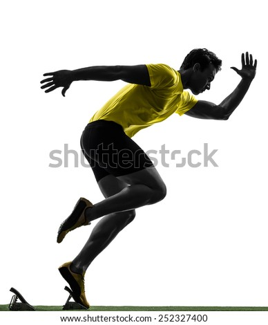 one  man young sprinter runner in starting blocks silhouette studio on white background - stock photo