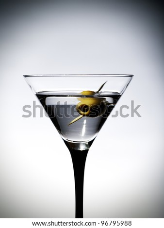 One martinis glass with olive - stock photo