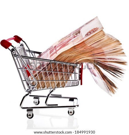One Million Banknotes Rubles of the Russian Federation in Shopping basket cart - isolated on white background - stock photo
