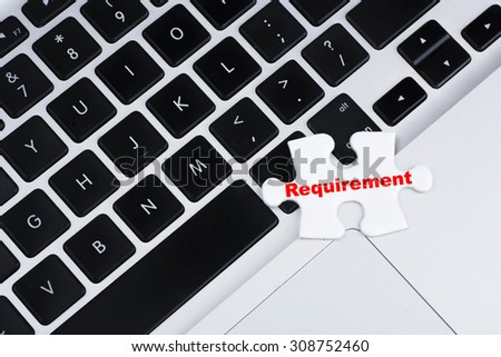 """One missing puzzle with red """"Requirement"""" text on laptop keyboard as background, business, finance and online concept - stock photo"""