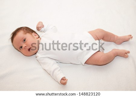 One month old infant laying on the back - stock photo