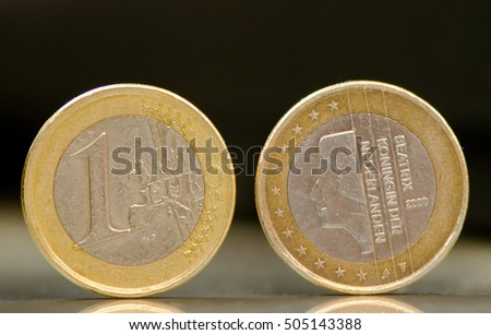 One Nederlanden euro coins on black background