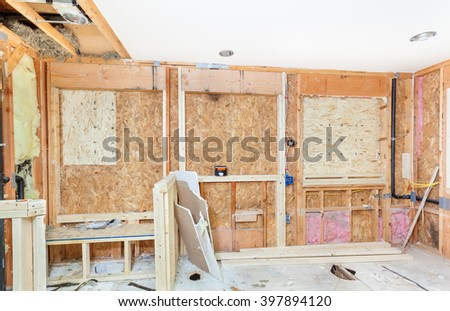 One new window and two resized have headers and framing complete - stock photo