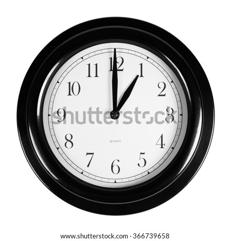One o'clock on the black wall clock, isolated on white background - stock photo