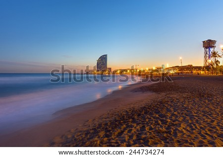 One of Barcelonas beautiful beaches after sunset - stock photo