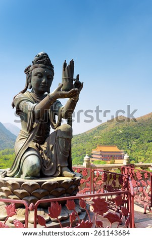 One of Buddhist statues praising and making offerings to the Tian Tan Buddha. The Po Lin Monastery and the blue sky in the background in Hong Kong. Hong Kong is popular tourist destination of Asia. - stock photo