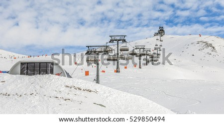 One of chair lifts in a ski resort of a valley of the Zillertal on a sunny day - Mayrhofen, Austria