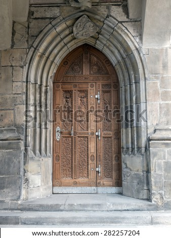 One of many doorways of Gothic Cathedral of Saints Vitus, Wenceslaus and Adalbert, Prague, Czech Republic - stock photo