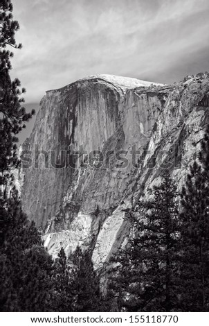 One of many famous sights at Yosemite National Park, this is a view of Half Dome from the valley floor. - stock photo