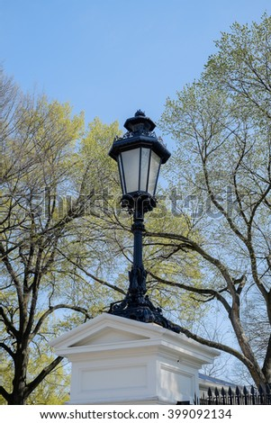 One of several beautiful lamp posts on the grounds of the White House in Washington DC - stock photo