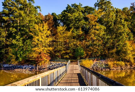 One of the fishing ramps at Lake Crabtree in Morrisville, North Carolina captured during autumn. This park is one of the best in the city just few miles away from Duke University.