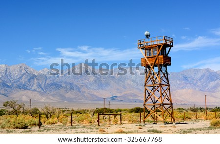 One of the guard towers at the Manzanar Detention Center in California where tens of thousands of people with Japanese ancestry were held during World War II - stock photo