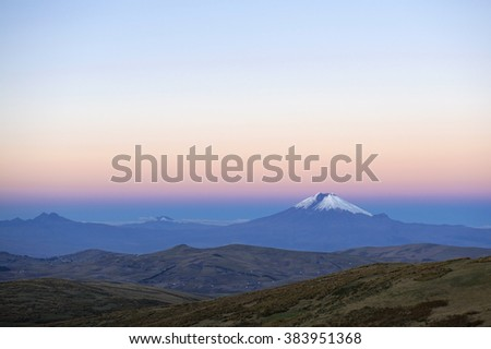 One of the highest active volcanoes in the world: the Cotopaxi volcano in Ecuador at sunset.  - stock photo