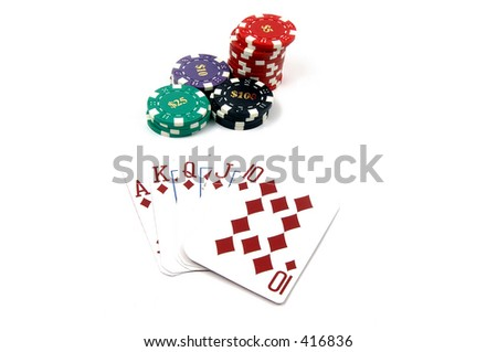 One of the highest hands in poker a Diamonds Royal Flush with a pile of casino chips, isolated on white Card are retired casino cards and the corners have been physically clipped