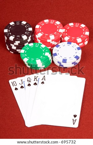 One of the highest hands in poker a Spades Royal Flush on a red felt gaming table with chips in the background  Ace of spades is blank for your logo