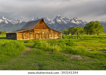 One of the homesteads of Mormon Row along the Jackson-Moran Road near the southeast corner of Grand Teton National Park, in the valley called Jackson Hole.  - stock photo