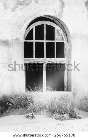 One of the houses of the Ghost town  Kolmanskop.  It was settled by German in 1908 with a purpose of diamond searching - stock photo