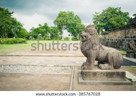 One of the 32 lion statues at the Borobudur buddhist temple, a UNESCO World Heritage site in Central Java, Indonesia. - stock photo