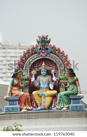 one of the many amazingly carved hindu temples in little india and Chinatown in Singapore - stock photo